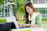 Asian women student with computer laptop Royalty Free Stock Photo