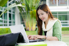 Asian women student with computer laptop. Beautiful young student smiling after interview job success Royalty Free Stock Image