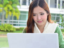 Asian women student with computer laptop Royalty Free Stock Images