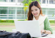 Asian women student with computer laptop. Beautiful young student smiling after interview job success Stock Image