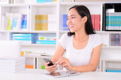 Asian women student happy with phone Stock Image