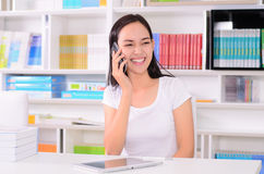 Asian women student happy with phone Stock Images