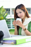 Asian women student smiling with coffee cup Royalty Free Stock Photo
