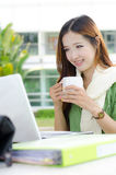 Asian women student smiling with coffee cup stock image