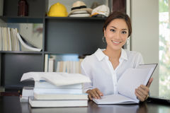 Asian women student smiling and reading a book for relaxation Stock Photo