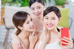 Asian women take selfie happily. Smiling skin care asian women friends take a selfie together royalty free stock photos
