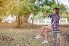 Asian women taking self picture selfie with smartphone Stock Photos