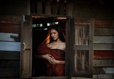 Asian women Thai dress in Thai drama. Thai dress of Retro Beautiful Thai lady in Thai traditional drama dress Stock Photography