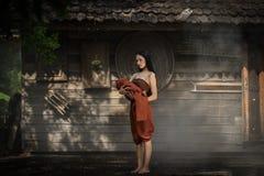 Asian women Thai dress in Thai drama. Thai dress of Retro Beautiful Thai lady in Thai traditional drama dress Stock Photos