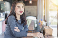 Asian women are thinking to create new jobs and are smiling and. Asian woman are thinking to create new jobs and are smiling and working happy Royalty Free Stock Image