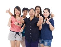 Asian women with thumbs up. Group of asian women with thumbs up, isolated on white background Royalty Free Stock Image