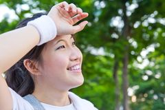 Asian women are tired after workout Royalty Free Stock Image