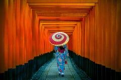 Asian women in traditional japanese kimonos at Fushimi Inari Shrine in Kyoto, Japan. stock photos