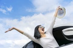 Asian women travel relax in the holiday. She leaned out of the car and raised her hands happily royalty free stock photos