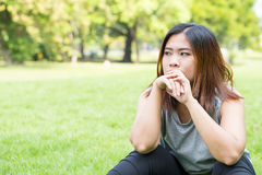 Asian women unhappy in the park Stock Images