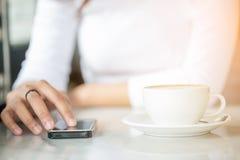 Asian women use smart phone Stock Photos