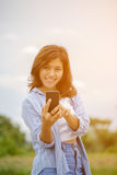 Asian women use smart phone Royalty Free Stock Photography
