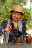 Asian women using old coffee maker. Asian woman using old style coffee grounding stock photos