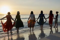 6 Asian women watching the sunset on Boracay island stock photos