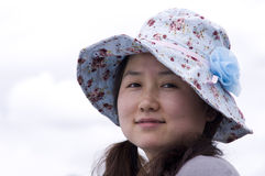 Asian women wear a hat Stock Image