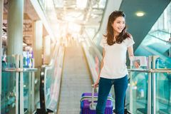 Asian women were carrying luggage royalty free stock photography