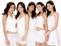 Asian Women in White #3. Five beautiful young asian women in white outfits on white background Stock Image