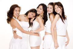 Asian Women In White #5. Five beautiful asian women in white on white Stock Photos