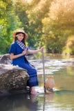 Asian women working in creek Royalty Free Stock Photos