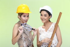Asian Women in yellow white safety hat and tools, smile laugh lo Royalty Free Stock Photo