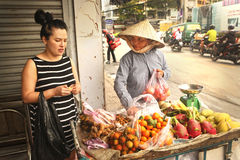 Asian wonam on market bue fruit Royalty Free Stock Photography