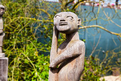 Asian wooden statue of idol in the park Stock Images