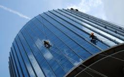 Asian worker climb on building, dangerous job Royalty Free Stock Photo