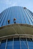 Asian worker climb on building, dangerous job Stock Image
