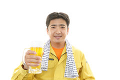 Asian worker drinking beer Royalty Free Stock Images