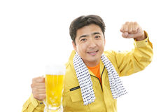 Asian worker drinking beer Royalty Free Stock Photo