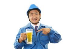 Asian worker drinking beer Royalty Free Stock Photography