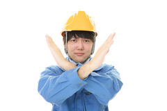 Asian worker making stop sign with crossed hands. Dissatisfied Asian worker isolated on white background Stock Photography