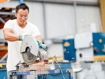 Asian worker in production plant on the factory floor royalty free stock image