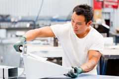 Asian worker in production plant on the factory floor stock photography