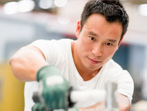 Asian worker in production plant on the factory royalty free stock images