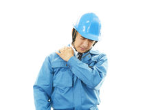 Asian worker with shoulder pain. Royalty Free Stock Photography