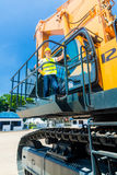 Asian worker on shovel excavator construction site Stock Images