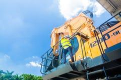 Asian worker on shovel excavator construction site Stock Image