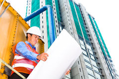 Asian worker or supervisor on building site Royalty Free Stock Photo