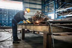 Asian worker using CNC plasma cutter Stock Photography