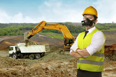 Asian worker wear safety vest and helmet. Over construction site Royalty Free Stock Photo