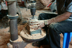 Asian worker, wood workshop, coconut product Royalty Free Stock Image