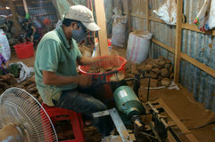 Asian worker, wood workshop, coconut product Stock Photo