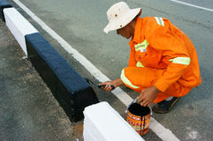 Asian worker working, traffic paint street Stock Photo