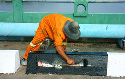 Asian worker working, traffic paint street Stock Image